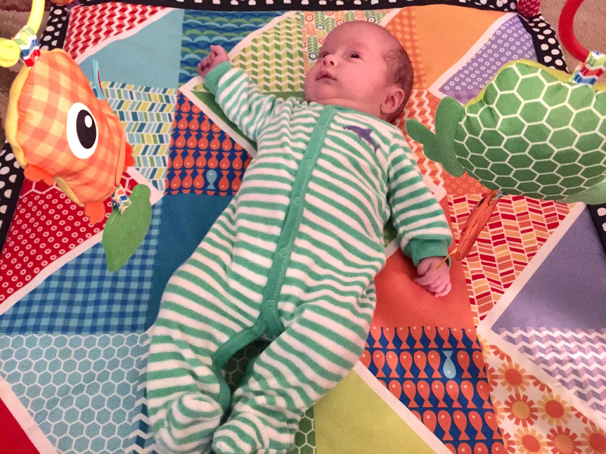 Spencer on play mat